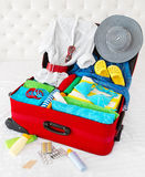 Travel suitcase packed for vacation Royalty Free Stock Photos