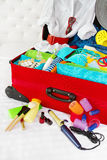Travel suitcase packed for woman vacation Stock Photography