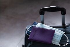 Free Travel Suitcase, Passport And Mask. The Ban On Travel During The Epidemic Of The Coronavirus And The Introduction Of Quarantine Royalty Free Stock Photos - 177231278