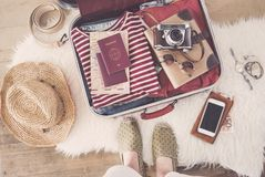 Travel suitcase preparing concept. On wooden background Stock Image