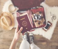 Travel suitcase preparing concept. Travel suitcase  preparing concept on wooden background Royalty Free Stock Images