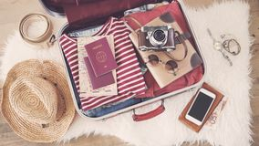 Travel suitcase preparing concept. Travel suitcase  preparing concept on wooden background Stock Photography