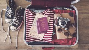 Travel suitcase preparing concept. On wooden background Stock Photography