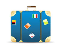 Travel suitcase/vector. Blue travel suitcase with postage stamps and pictures with flags on it Royalty Free Stock Photography