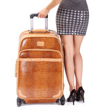 Travel Suitcase and Woman's Sexy Legs islated on white backgroun Stock Image