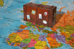 Travel suitcase. With world map Stock Photos