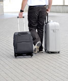 Travel with suitcases. On wheels Stock Photography