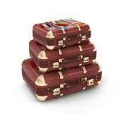 Travel suitcases in stack. Isolated Stock Images