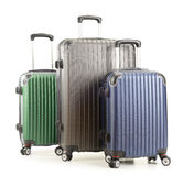 Travel suitcases on white background Stock Photos