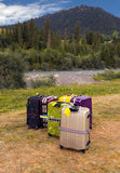 Travel Suitcases in Wilderness Area Royalty Free Stock Image