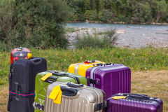 Travel Suitcases in Wilderness Area Stock Images