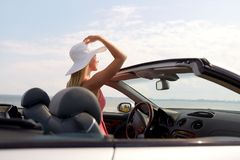 Happy young woman in convertible car Royalty Free Stock Photo
