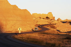Travel at Sunset. Vacationing in a recreational vehicle in the Badlands National Park Stock Images