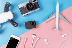 Travel technology gadgets on pastel background Stock Image