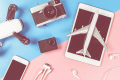 Travel technology objects on pink with blue pastel. Background Royalty Free Stock Image