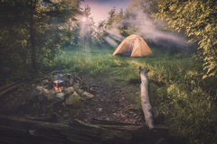 Travel tent in a light of sunrise. Instagram stylization royalty free stock photography