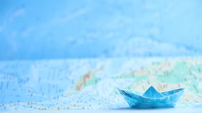 Travel text on paper boat. Travel inscription on paper boat and map stock video