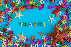 Travel text with starfishes and many color letters. Time to travel text written on photo frame, Summer time and vacation. Concept Royalty Free Stock Images