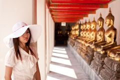 Travel in Thai temple. Smiling young thai girl and white hat travel in temple thai Royalty Free Stock Photos
