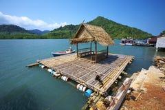 Travel in thailand. Little hut on blue sea in thailand Stock Photos