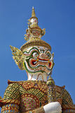 Travel in thailand. White gian stand in sun light Stock Image
