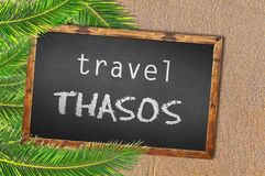 Travel Thasos palm trees and blackboard on sandy beach. Close Royalty Free Stock Images