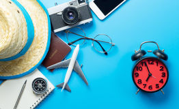 Travel time with accessories and alarm clock. Summer travel time with accessories and alarm clock royalty free stock photography