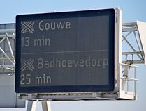 Travel time information dispay to motorway crossing Gouwe and Badhoevedorp on A12 at The Hague.  royalty free stock photography