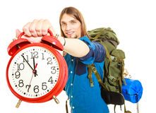Travel time season. Man backpacker holding clock. Royalty Free Stock Photography
