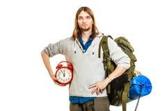 Travel time season. Man backpacker holding clock. Stock Photo