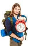 Travel time season. Man backpacker holding clock. Royalty Free Stock Image