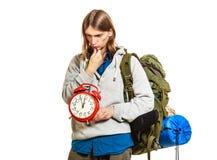 Travel time season. Man backpacker holding clock. Stock Image