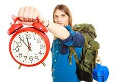 Travel time season. Man backpacker holding clock. Royalty Free Stock Photography