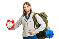 Travel time season. Man backpacker holding clock. Royalty Free Stock Photos