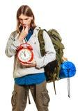 Travel time season. Man backpacker holding clock. Stock Photos