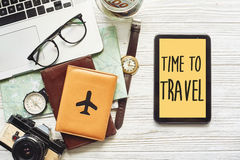 Travel. time to travel concept text sign on yellow tablet screen Royalty Free Stock Image