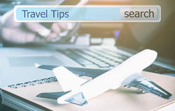 Travel Tip search button on travel agency Stock Photos