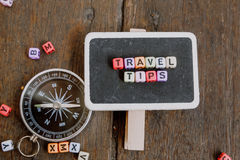 TRAVEL TIP word block on wooden signage with compass concept Royalty Free Stock Photography