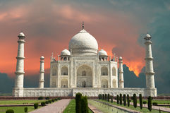 Travel to Agra, India, Taj Mahal and Red Stormy Sky. Artist rendition of the Taj Mahal. A red, stormy sky with angry clouds are a backdrop for the taj Mahal. The Royalty Free Stock Image
