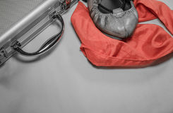 Travel to basque country local holiday summer festival fetes de bayonne coming up concept with shoe, red scarf and suitcase Stock Photography