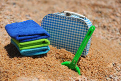 Travel to the beach. Suitcase and toys at the summer beach on vacation Stock Images