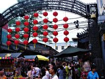 Travel to Beijing city, China. Touriam, people and red hanging lanterns. Travel to Beijing city, China. Tourism, people, red hanging lanterns, street food royalty free stock images