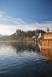 Travel to bled, wooden boathouse, castle on top of the hill on lake bled in julian alps Stock Photo