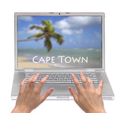 Travel to Capetown. Hands typing on laptop with Capetown beach on screen, isolated Royalty Free Stock Image