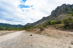 Road in The Valley of Ghosts in Crimea. Travel to Crimea - country road in The Valley of Ghosts on Crimean Southern Coast Stock Image