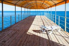 Lounge in outdoor solarium over Black Sea Royalty Free Stock Photos