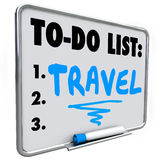 Travel To Do List Dream Vacation Wish Priorities Word. Travel word written on a dry erase board with blue marker as a priority or goal to reach in your life Stock Image