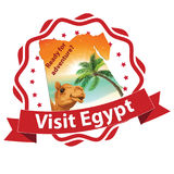 Travel to Egypt advertising for travel agencies. Visit Egypt - stamp / badge. Business travel agency stamp / label for summer holidays with camel and sand dunes Stock Images