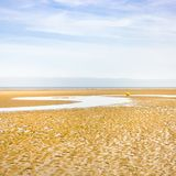 Blue sky over sand beach of Le Touquet after ebb. Travel to France - blue sky over sand beach of Le Touquet after ebb tide (Le Touquet-Paris-Plage) on coast of Royalty Free Stock Photo