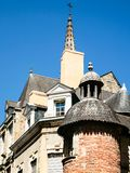 Houses and tower of church Notre-Dame in Vitre. Travel to France - old urban houses and tower of church Notre-Dame in Vitre town in Ille-et-Vilaine department of Royalty Free Stock Images